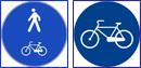 immagini dei cartelli stradali di pista ciclabile e passaggio promisquo
